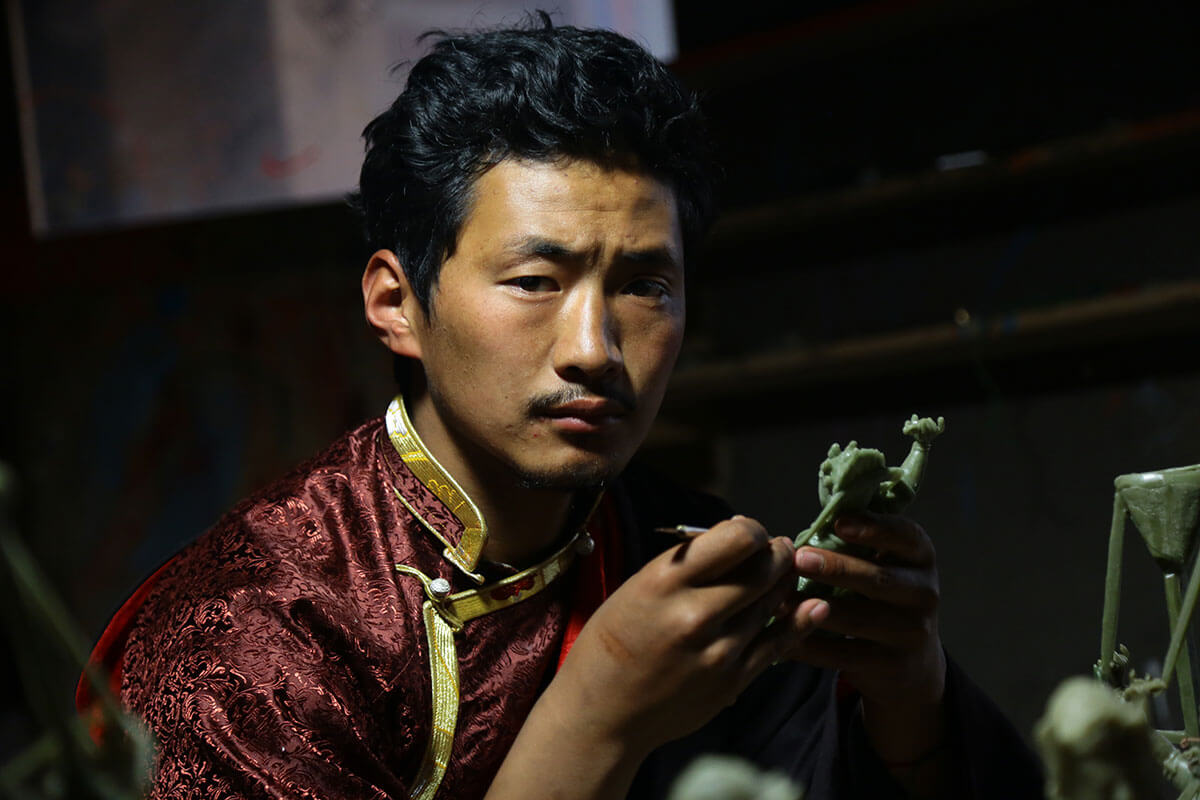 Bronze artist and designer Dawa Dakpa is the seventh generation of the Khyentse bronze lineage.