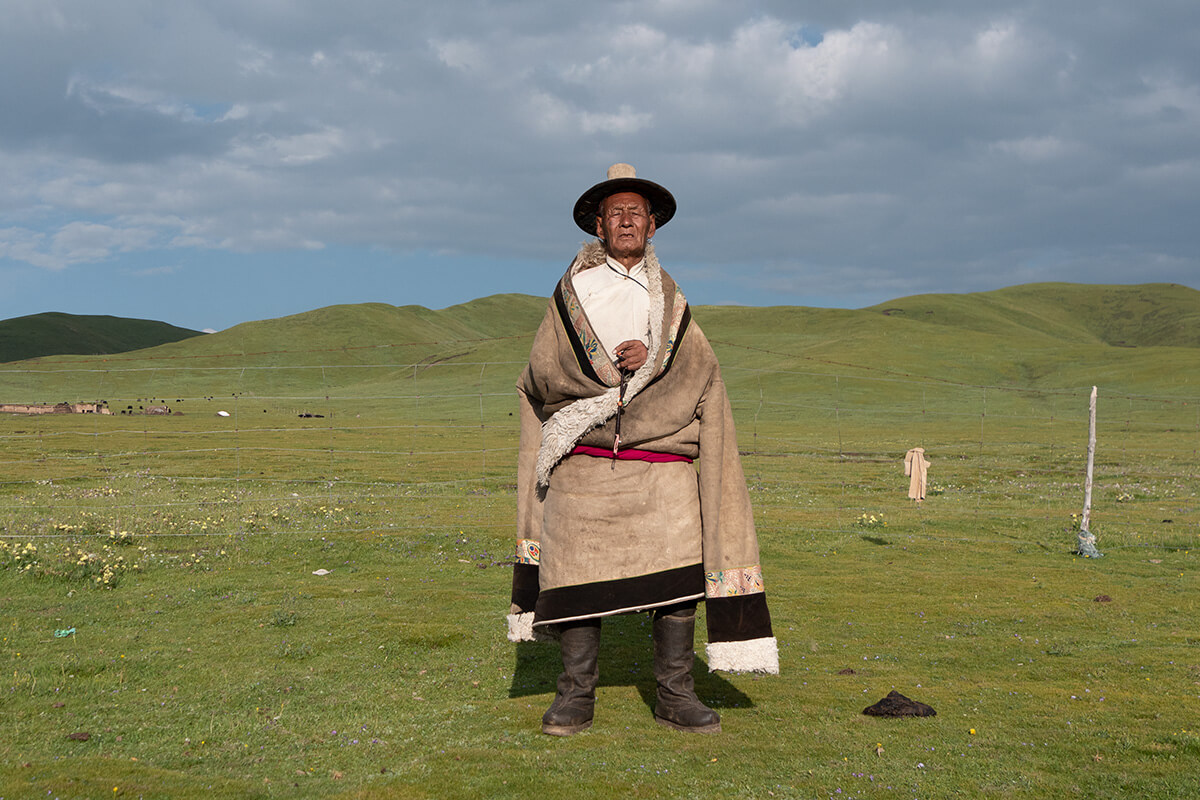 Aba Gelu Gyal wearing Tibetan cloth in Sonak Village, Qinghai Province.