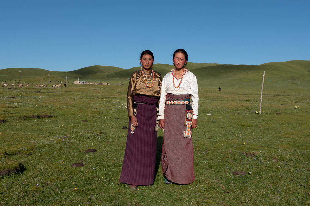 Young girls wearing Tibetan cloth in Sonak Village, Qinghai Province.