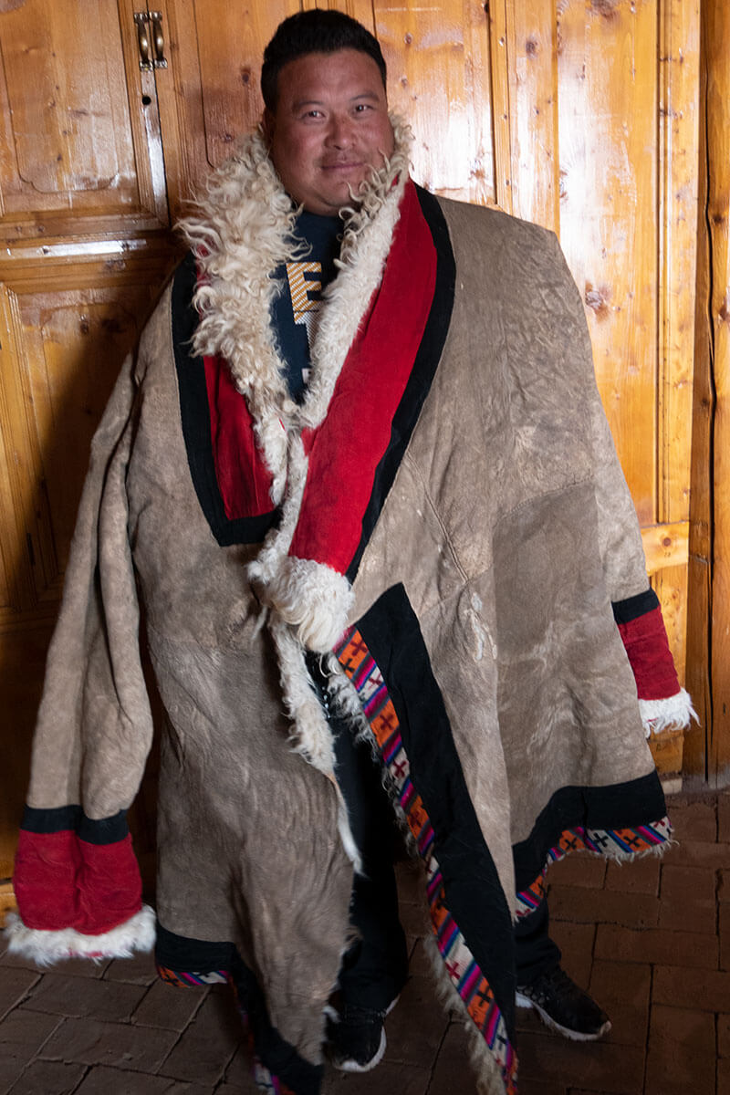 Man wearing Tibetan cloth in Zhün ha County, Qinghai.