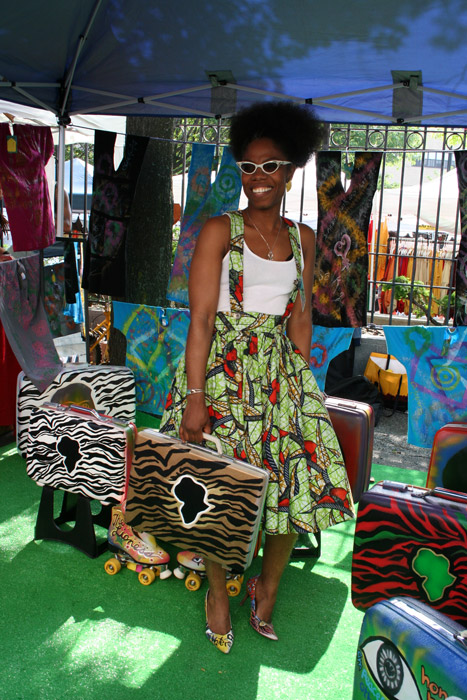 "This artisan of style creates and sells unique Afrocentric, artsy designs that are both contemporary and ""throwback"" made from recycled items."