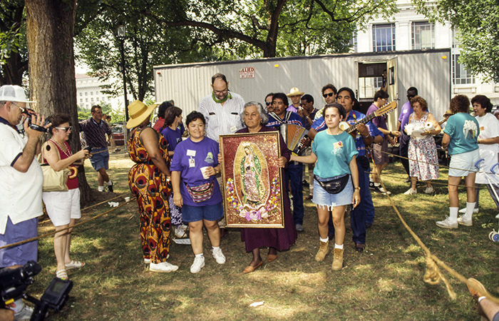<em>La Virgen</em>'s procession from the trailer to the Festival grounds. Photo by Jeff Tinsley, Ralph Rinzler Folklife Archives and Collections, Smithsonian Institution