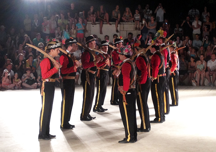 "A group from Lastovo Island performs a sword dance at the Sword Dance Festival in Korčula. Here they are in ""contra formation."""