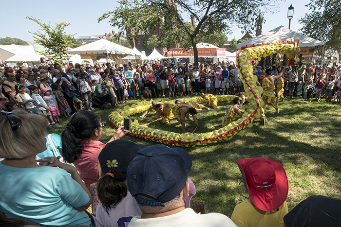 The Wu Opera's dragon dance troupe performs in People's Park during the 2014 Folklife Festival.