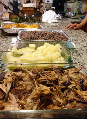 Roast pork, yucca with mojo, congri, and plantains for Christmas Eve dinner, 2013. Photo by Cecilia Peterson