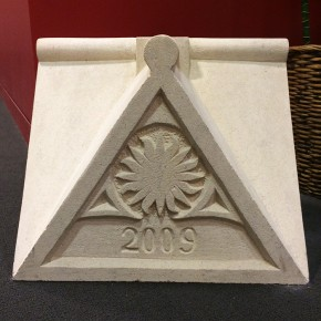 The completed apex stone now adorns the Center's lobby.