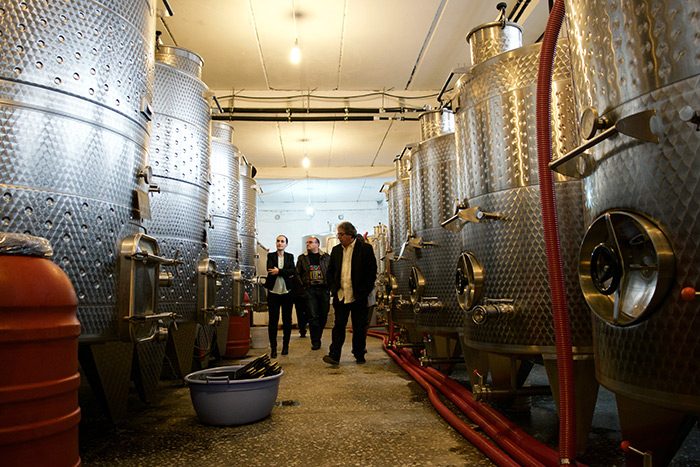 Irina, My Armenia project specialist Hamazasp Danielyan, and Vahe walk through the Semina Cooperative Winery.