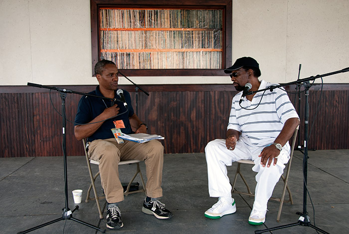 Curator Mark Puryear interviews soul singer William Bell with the Stax Music Academy at the 2011 Folklife Festival's <em>Rhythm and Blues</em> program. Photo by Michelle Arbeit, Ralph Rinzler Folklife Archives