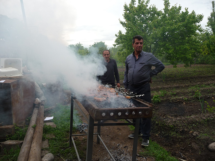 The barbecue crew in action. Photo by Betty Belanus, Smithsonian