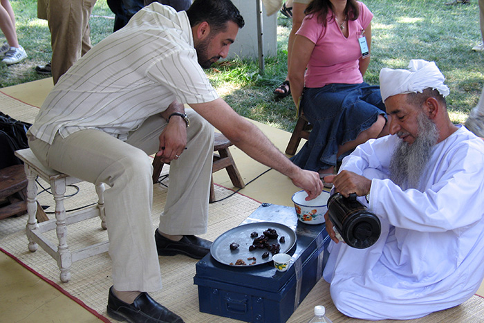A presentation of Omani hospitality with dates and coffee at the 2005 Folklife Festival. Photo by Rebecca Summerour, Ralph Rinzler Folklife Archives