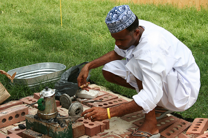 A participant prepares coffee at the 2005 Folklife Festival's Oman program. Photo by Jillian Foley, Ralph Rinzler Folklife Archives