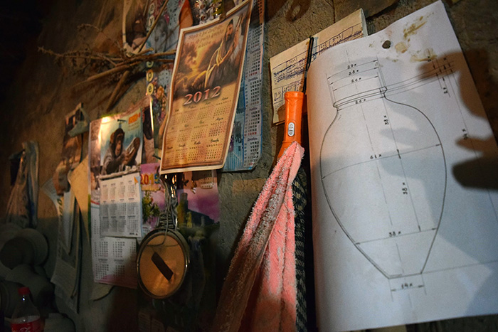 A technical drawing of a karas hangs on the wall of Serioj Asatryan's pottery studio in Yuva village.
